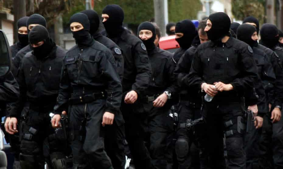 French police officers near the scene of Mohamed Merah's death, Toulouse, France, 2012