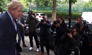 Boris Johnson being photographed leaving home this morning.