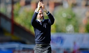 Cambridge United manager Shaun Derry applauds the travelling Cambridge fans after his teams 1-0 defeat to Exeter.