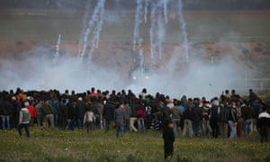 Israeli troops fire teargas at Palestinians protesting near the Gaza border fence