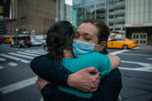 Medical workers embrace, New York.