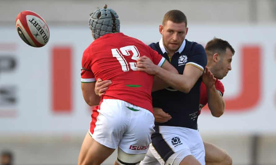 Scotland fly half Finn Russell is sandwiched between Jonathan Davies (left) and Gareth Davies during the Six Nations win over Wales in Llanelli