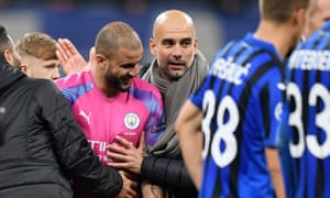 Kyle Walker is congratulated by Pep Guardiola after Manchester City held on for a draw.