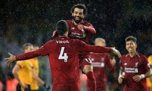 Mohamed Salah celebrates with Virgil van Dijk after scoring Liverpool's first goal. Salah then provided the assist for Van Dijk to add a second.
