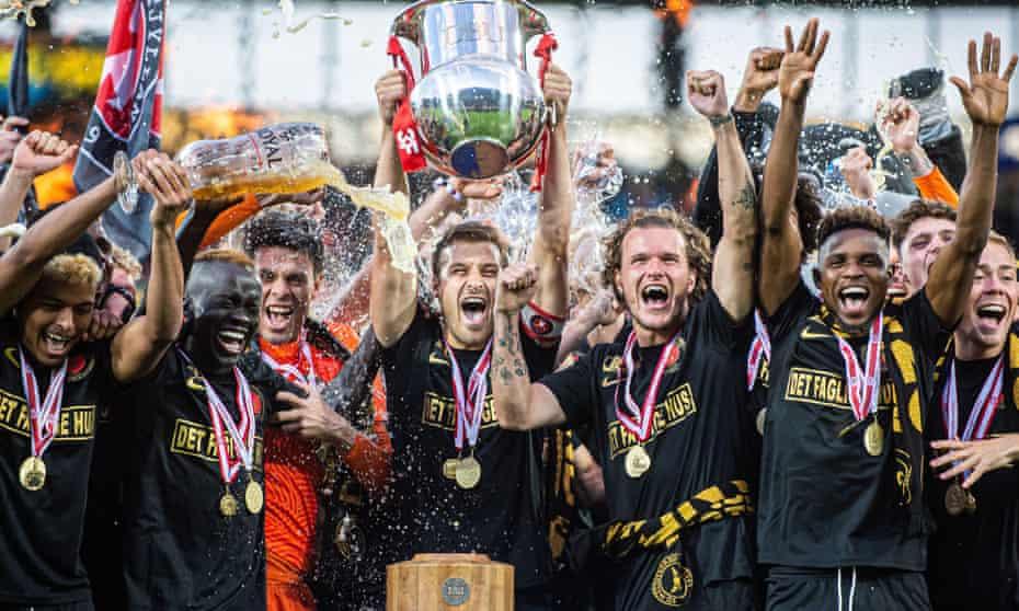 Midtjylland's captain, Erik Sviatchenko, lifts the Danish Superliga trophy on 26 July