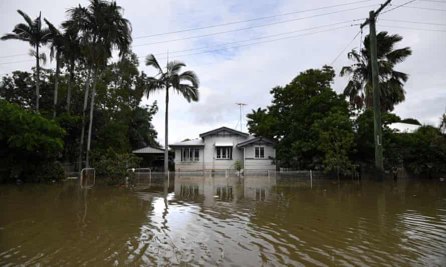 A house is surrounded by flood water in the suburb of Hermit Park in Townsville, Queensland, Australia, 6 February 2019.