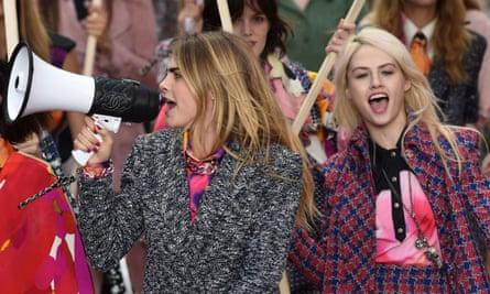 Model Cara Delevingne with megaphone on the catwalk