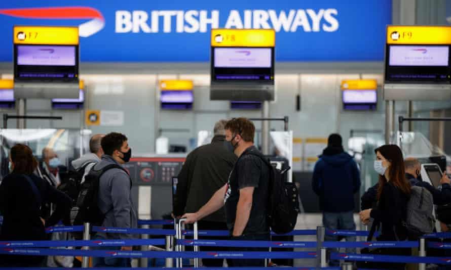 Passengers at terminal 5, Heathrow airport.