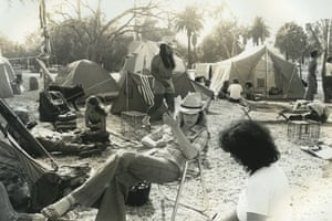 In June 1981, military veterans staged a hunger strike to protest planned budget cuts to veterans' healthcare after the untimely death of a former Vietnam Marine, James Hopkins. Vowing to fast until 4 July, the demonstrators demanded an independent review of Veteran's Administration (VA) hospitals, a study on the effects of Agent Orange, greater support for veterans' mental health and a meeting with Ronald Reagan. Hopkins' wife, Suzanne Hopkins, is pictured at the tent encampment outside the Wadsworth VA Hospital in Los Angeles.