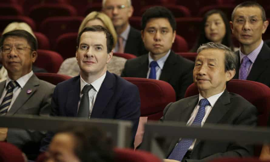 George Osborne watches a Chinese production of War Horse with China's vice premier Ma Kai in Beijing.