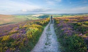 A hiker walking across Exmoor national Park in Devon