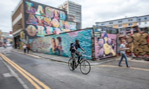 A cyclist on Rivington Street in London