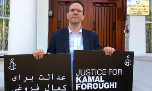 Kamran Foroughi, son of detainee Kamal Foroughi, protests outside the Iranian embassy in London.