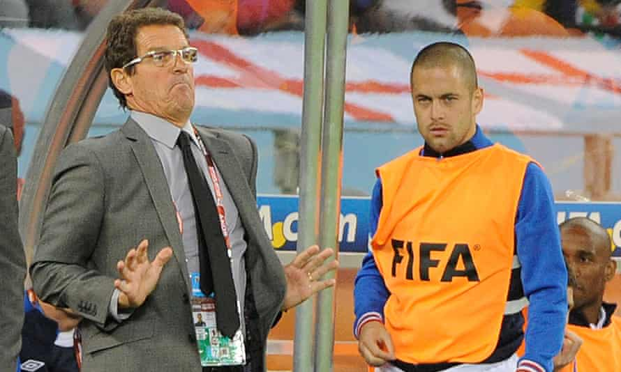Joe Cole on the bench with Fabio Capello during England's 2010 World Cup group game against Algeria.