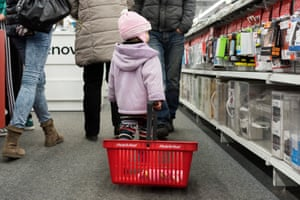 A girl pulls a basket at an electronics store in Nyiregyhaza, Hungary
