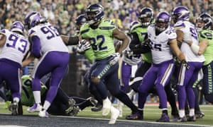 Chris Carson scores on a run against the Vikings during the first half.