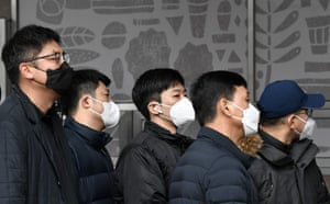 Workers queue for coronavirus tests at a temporary facility in Seoul in South Korea