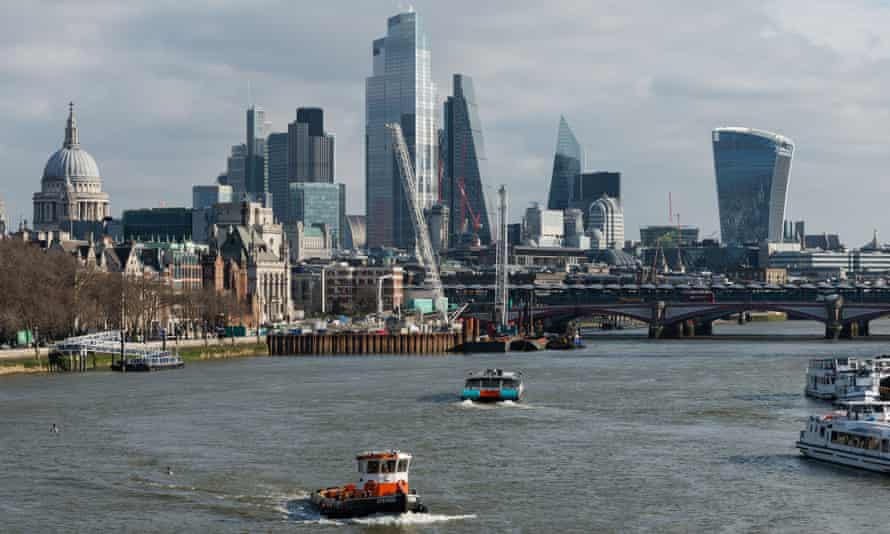A view of the skyscrapers of the City of London financial district over the River Thames