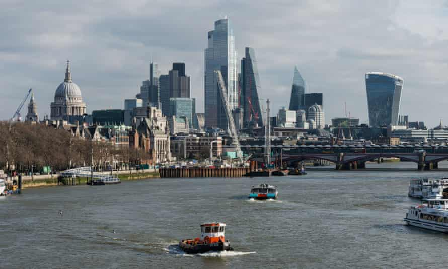A view of the skyscrapers of financial district of the City of London over the River Thames