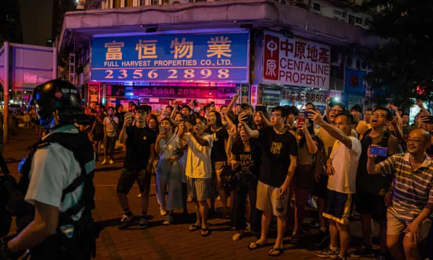 Residents of Whampoa join protesters outside the MTR station and shout at police after one protester was arrested on Saturday.