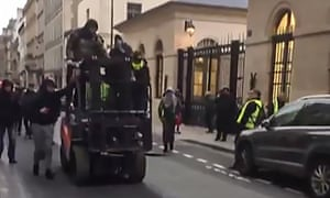 A grab from footage of protesters on a forklift drive used to ram through the entrance to a ministry annexe housing a government spokesman.