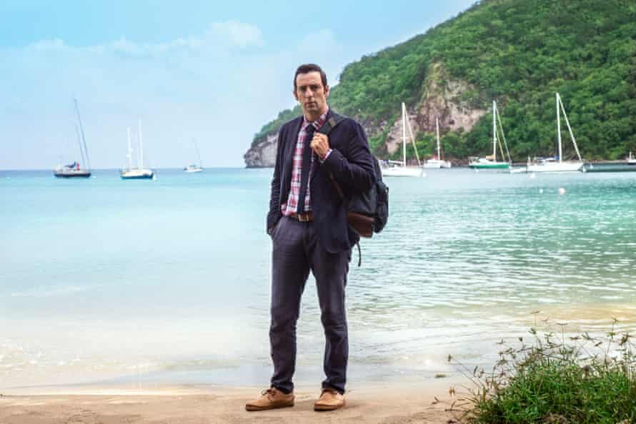 Ralf Little as DI Neville Parker in Death in Paradise.