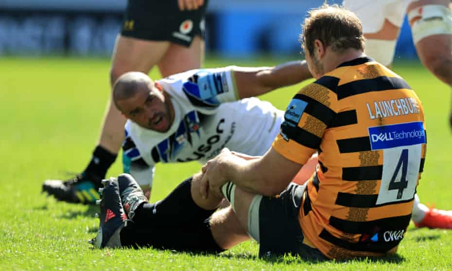 Joe Launchbury goes down holding his left knee after a collision with Bath's Jonathan Joseph