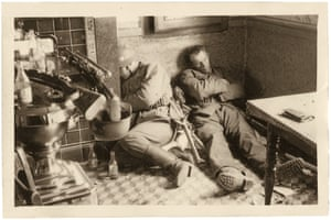 Soldiers resting after fighting against the retreating British on the River Scheldt in southern Belgium, May 1940