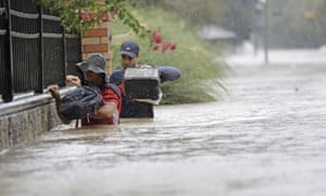 Residents wade through floodwaters in Houston.