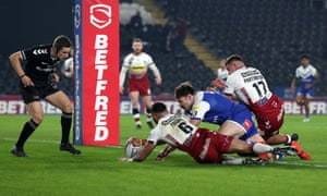 Alex Walmsley of St Helens dives in vain as he attempts to score.