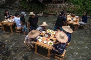 Kampung Kemensah, Malaysia Customers eat lunch in a stream on the outskirts of Kuala Lumpur