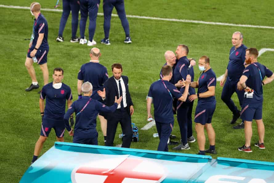 Gareth Southgate celebrates with back room staff at the final whistle