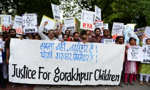 Activists protest in Delhi over the deaths of at least 64 children at a hospital in northern India