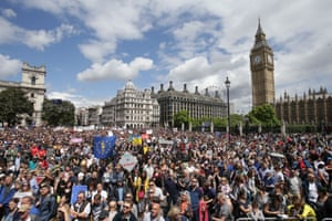 Protesters wearing EU flags as capes and holding banners saying 'Bremain' and 'We Love EU' gather in Parliament Square