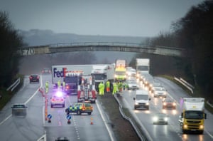 A jack-knifed FedEx lorry hit the central reservation on the M8 at Bathgate, West Lothian, closing lanes in both directions as Storm Desmond hits the UK.