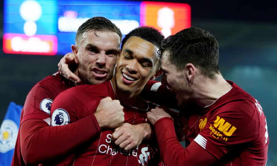 Liverpool's Trent Alexander-Arnold (centre) celebrates with Jordan Henderson and Andrew Robertson after scoring the final goal in the 4-0 win at Leicester.