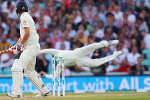 Chris Woakes of England looks back to see Steve Smith of Australia take a catch to dismiss him.