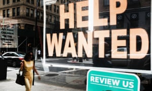 A help wanted sign is displayed in the window of a Brooklyn business in New York.