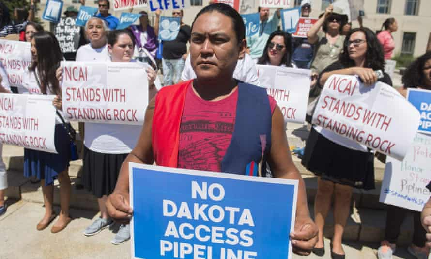 Protesters hold a rally with the Standing Rock Sioux tribe in support of a lawsuit against the army Corps of Engineers and plans for the Dakota Access Pipeline outside the US district court in Washington DC on Wednesday.