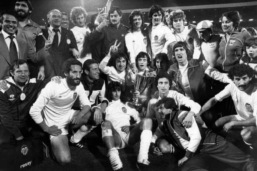 The jubilant Valencia players celebrate with the trophy.