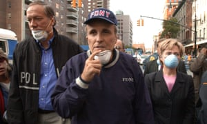 Rudy Giuliani and Hillary Clinton tour the site of the World Trade Center disaster on 12 September 2001.