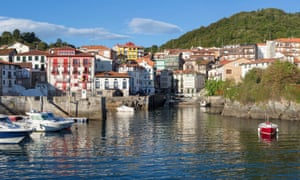 The harbour, with several small fishing boats, at Mundaka, Basque country, Spain.