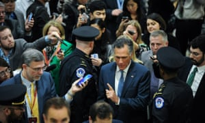 Senator Mitt Romney, the 2012 Republican presidential nominee, is swarmed by reporters as he makes his way to the impeachment trial.
