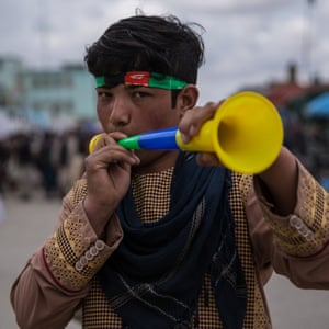Safi Ullah, 14, from Mazar-e-Sharif plays a trumpet during Nowruz celebrations.