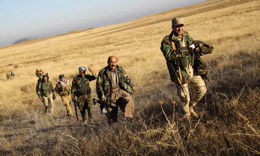 A peshmerga unit crossing into enemy territory outside Sinjar on Thursday.
