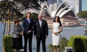 Prince Harry and Meghan pose with Sir Peter and his wife Lynne Cosgrove at Admiralty House on Sydney Harbour