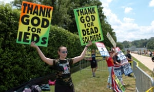 Megan Phelps-Roper in 2006, then a junior at Washburn University, protests outside the gates of the Arlington National Cemetery funeral of Marine Lance Cpl Kevin A Lucas with the Westboro Baptist Church