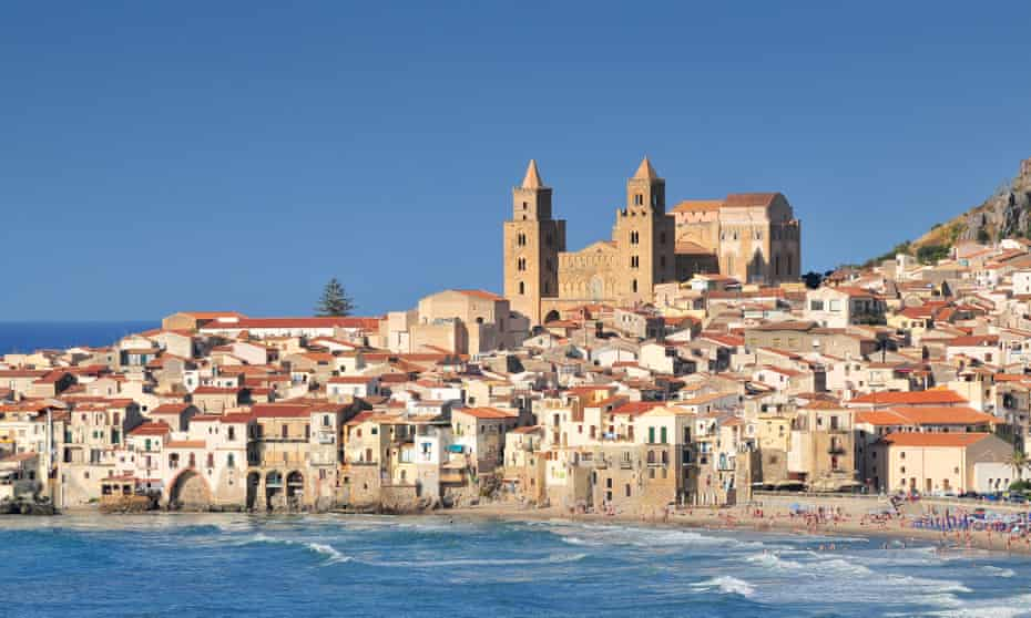 Houses and cathedral in background Cefalu Sicily