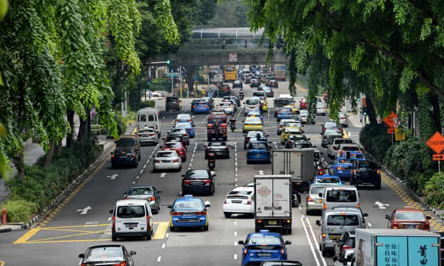 Motorists enter the financial district area in Singapore.