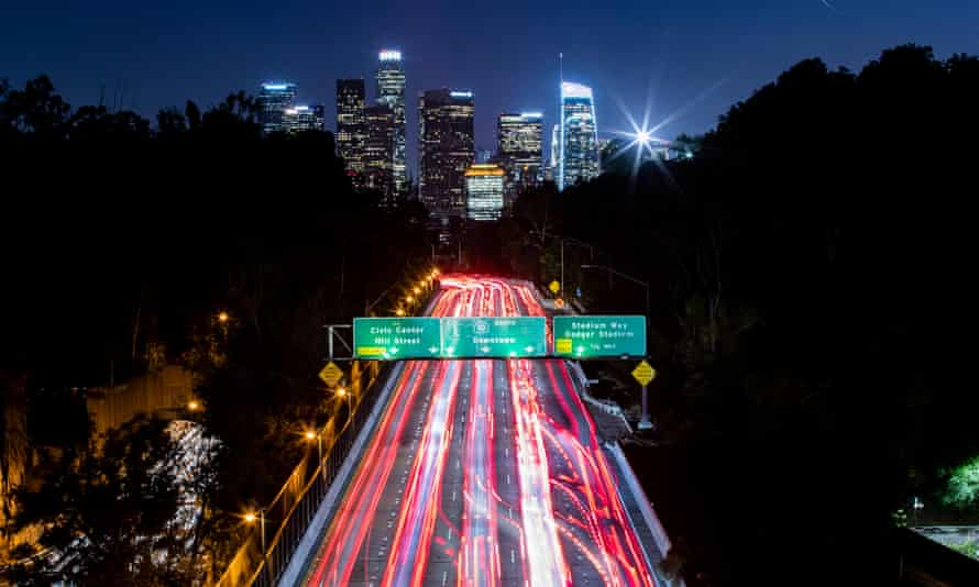The taillights of cars on a freeway in Los Angeles.